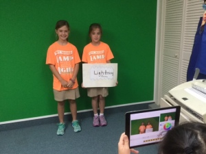 Students in Mr. Parker's Fourth Grade Class producing videos using iPads and a green screen.